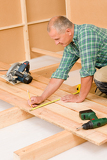 Fotografie Handyman home improvement wooden floor renovation