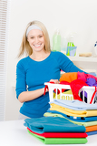 Fotografie Laundry - woman folding clothes home