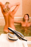 Fotografie Relax spa pool two naked women inside