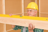 Fotografie Handyman mature professional with spirit level