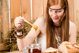 Fotografie Red-hair young hippie woman have breakfast in barn