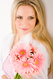 Romantic woman hold pink gerbera daisy
