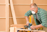 Photo Handyman sanding wooden board diy home renovation