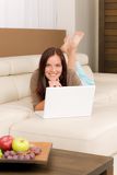 Modern living room woman lying sofa laptop