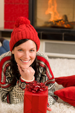 Christmas present woman lying floor home fireplace