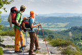 Fotografie Hiking young couple point at panoramic view