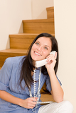 Home living woman call phone sitting staircase