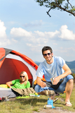 Camping young couple with tent cook countryside