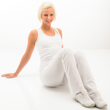 Fitness woman posing sitting on white floor