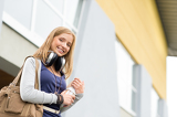 Student carrying books to school headphones young