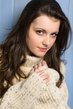 Winter brunette woman in beige sweater