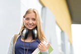 Student girl with headphones smiling at camera