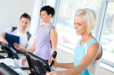 Fitness young people on treadmill cardio workout