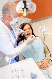 Dentist checkup procedure female patient on chair
