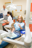 Happy patient woman at dental surgery