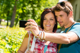 Fotografia Young couple in love take picture themselves