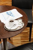 Coffee break business table with reports charts
