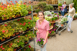 Garden centre woman shopping plants
