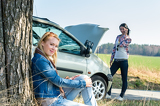 Car defect two women waiting for help