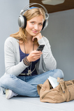 Teenage woman holding her mobile phone