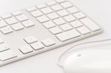 Fotografie White keyboard with computer mouse