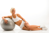 Fotografie Woman in white fitness outfit exercise ball