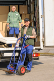 Fotografia Mover two man loading furniture on truck