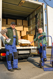 Fotografie Two mover load van with furniture boxes