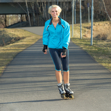 Fotografie Woman roller skating in park smiling summer