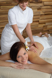 Fotografie Luxury spa room woman back massage