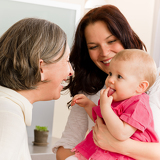 Fotografie Happy family women - grandmother, mum and baby