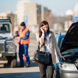 Fotografie Woman on the phone after car crash