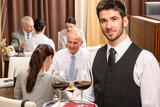 Fotografia Waiter hold wine glasses business lunch restaurant