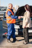 Fotografie Woman greeting mechanic after her car breakdown