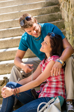 Fotografie Couple smiling at each other on stairs