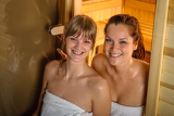 Fotografie Two women at sauna wrapped in towel