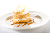 Fotografie Delicious creamy dessert with caramel topping