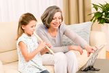 Fotografie Grandmother teach young girl play flute happy