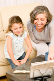 Fotografia Grandmother teach young girl learn music notes