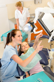 Smiling dentist with child at surgery