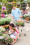 Garden center family shopping flowers