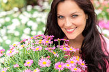 Fotografie Portrait of beautiful woman with purple flowers