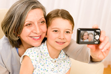 Fotografie Grandmother and young girl take picture themselves