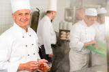 Fotografie Professional kitchen smiling chef add spice food