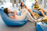 Fotografie Group of students relax on beanbag