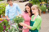 Garden center florist selling flowers to couple