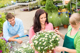 Florist assist woman choose flowers garden store