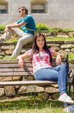 Young people relax on park bench