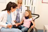 Fotografie Young girl on wheelchair visit doctor