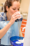 Dental patient woman rinse mouth after treatment